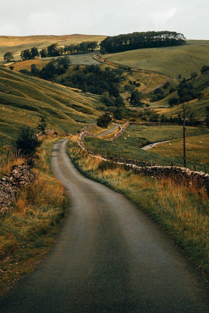North Yorkshire road through the countryside by Illiya Vjestica on Unsplash